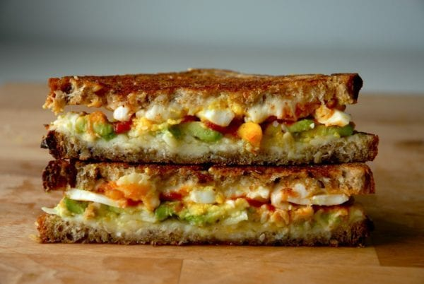 breakfast grilled cheese filled with avocado, sriracha, and egg