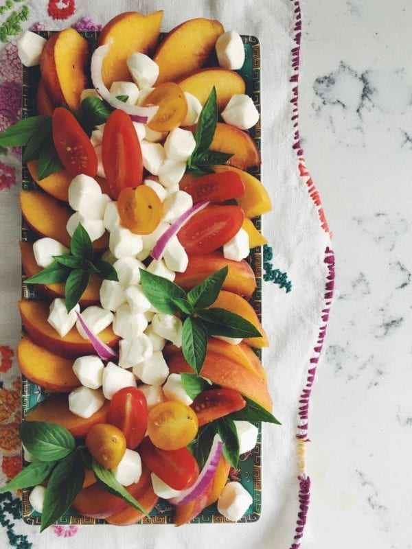 Savor summer forever with this quick and easy peach, mozzarella and thai basil salad!