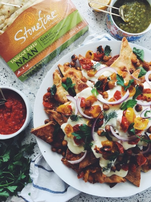 These tasty naan nachos are smothered in a creamy feta cheese sauce with roasted tomatoes, chick peas and fresh herbs!