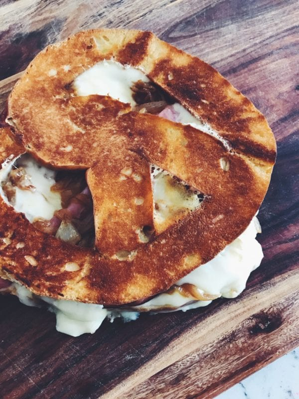 Pretzel Grilled Cheese with Caramelized Onions, Ham, and Gouda Cheese