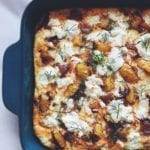 Summer Squash Frittata with Goat Cheese, Dill and Caramelized Onions  in a green baking dish