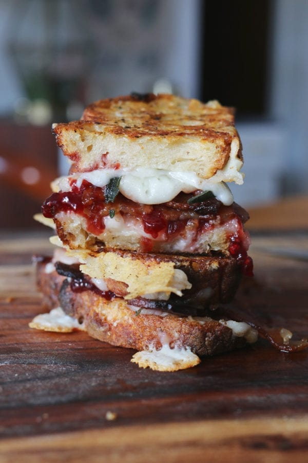 goats milk cheddar grilled cheese with sour cherry jam, crispy fried sage, bacon + black pepper butter on sourdough