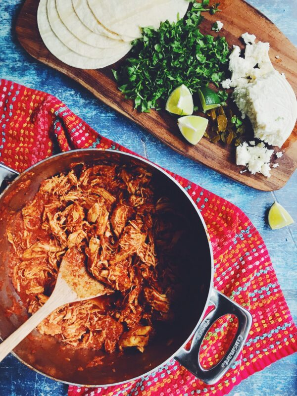 the easiest spicy chicken tinga recipe ever! Perfect mexican shredded chicken for tacos, quesadillas, salad bowls and tostadas!