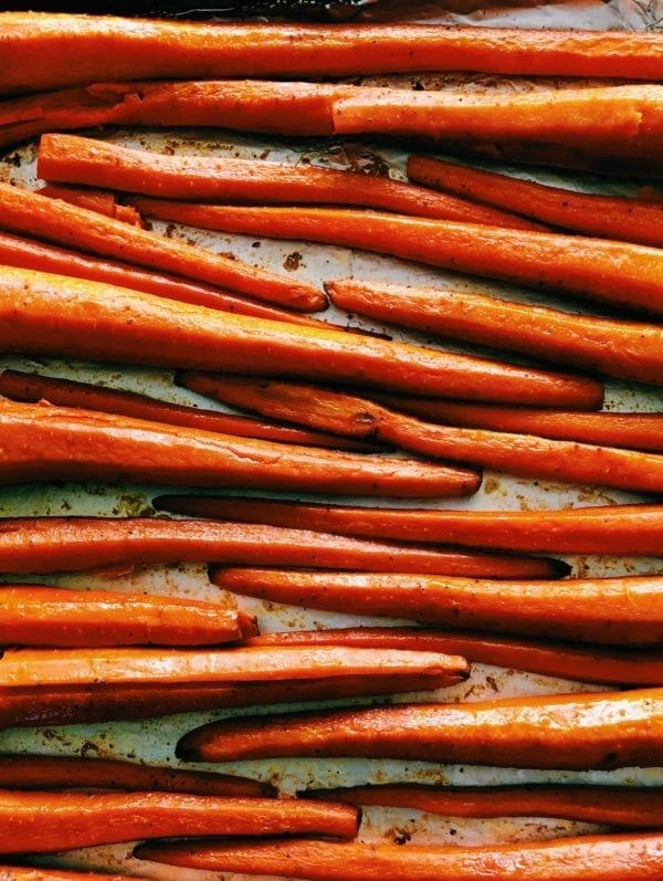 Honey Sriracha Roasted Carrots with Goat Cheese, Pepitas + Cilantro