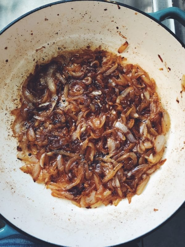 caramelized onions in a white ceramic pot