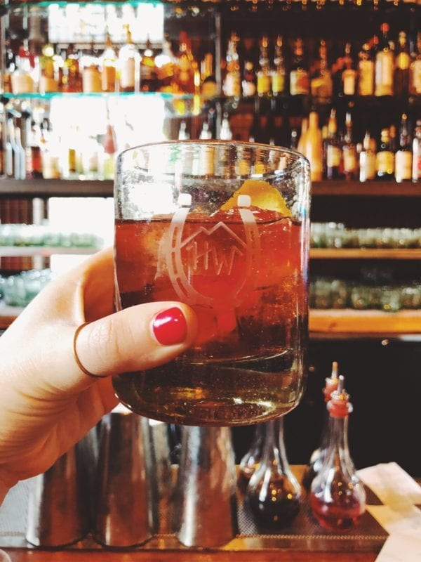 a hand holding a cocktail at High West Distillery in Park City Utah