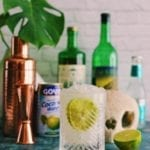 a clear cup with a lime filled with a Skinny Mezcal Coco Rita