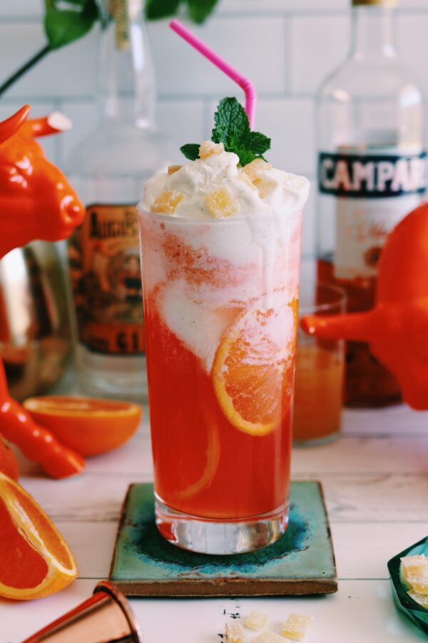 an orange cocktail with ice cream on top