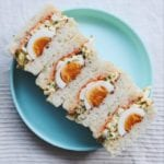 egg salad sandwiches on a blue plate