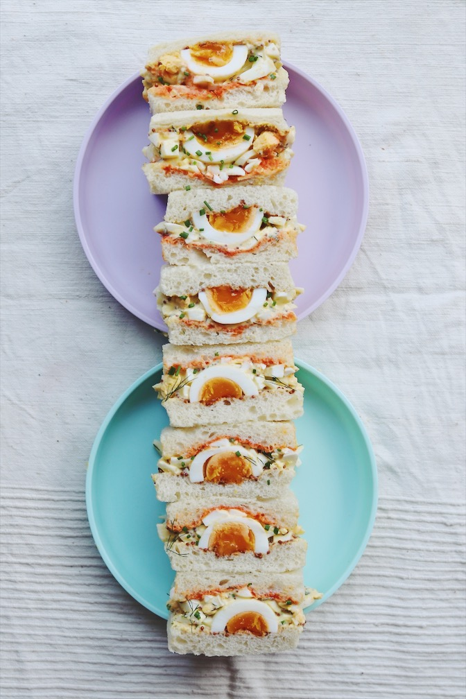 egg salad sandwiches on a blue and purple plate