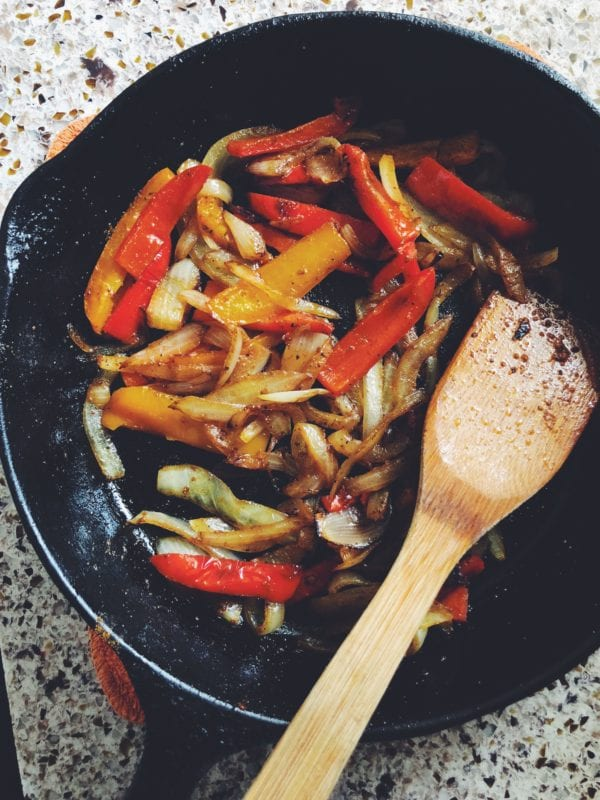 caramelized peppers and onions in a frying pan