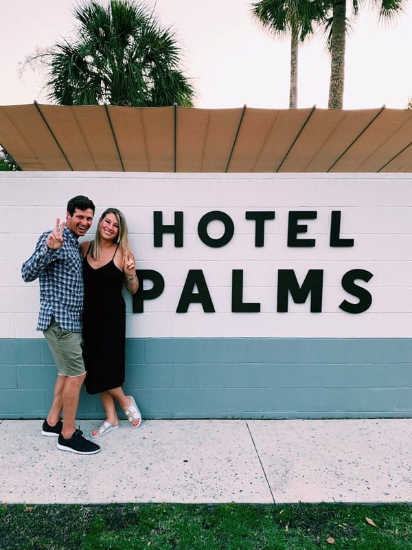 2 people standing in front of Hotel Palms Atlantic Beach Jacksonville Florida