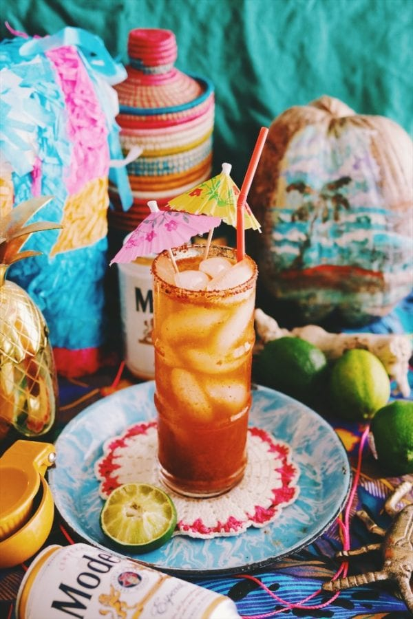 a red michelada on a brightly colored table