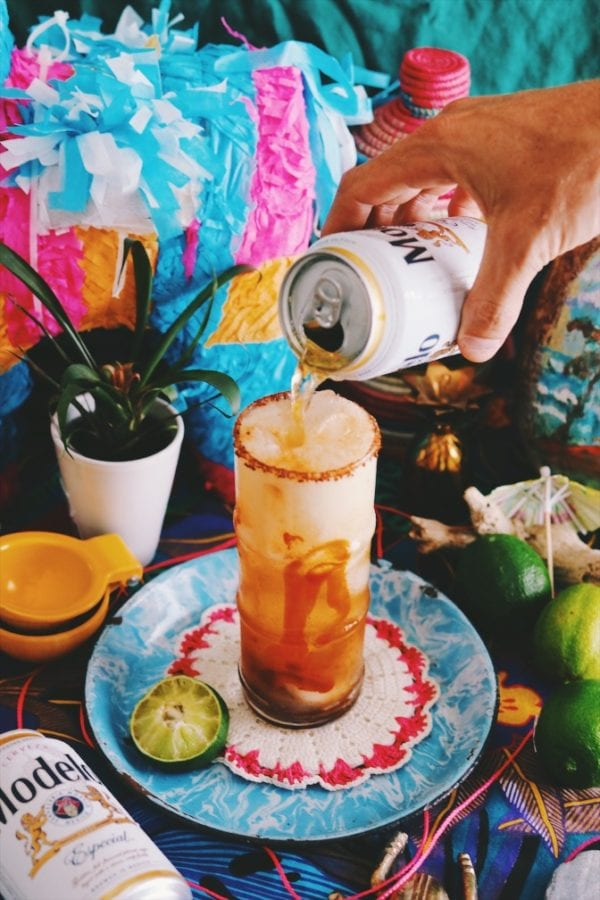 a beer being poured into a michelada