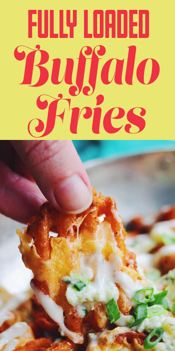 These buffalo fries are the perfect vegetarian alternative to buffalo wings! Extra crispy waffle fries are tossed with buffalo sauce and baked with cheddar cheese. Then they're topped with crumbled blue cheese, a drizzle of ranch dressing and chopped scallions. They're easy to make and out of this world delicious! #buffalo #appetizer #easyapp #fries #gameday #partyfood