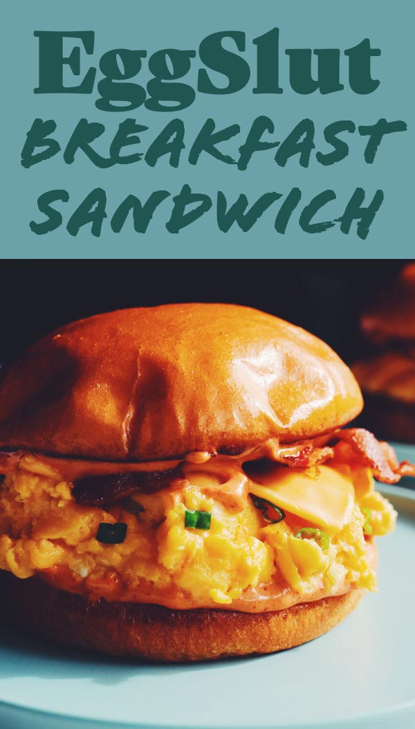 This knockoff EggSlut Sandwich is so incredibly delicious! Inspired by their iconic Fairfax breakfast sandwich, it's loaded with cheesy soft scrambled scallion eggs, sriracha mayo, crispy bacon and a buttery toasted brioche bun. It's the perfect sandwich for hangovers, brunches, or mornings when you need a little something extra to start your day.