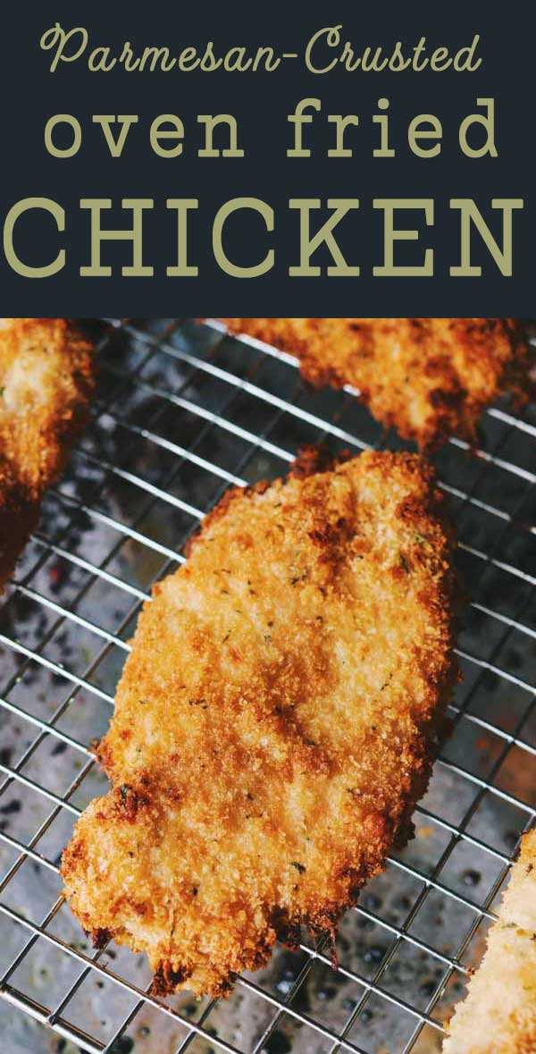 This oven fried parmesan crusted chicken is ridiculously delicious! Crispy panko, cheesy parmesan and moist buttermilk brined chicken breasts come together perfectly in this oven baked fried chicken recipe! Trust me when I say that you'll keep this easy chicken recipe on constant rotation after trying it!
