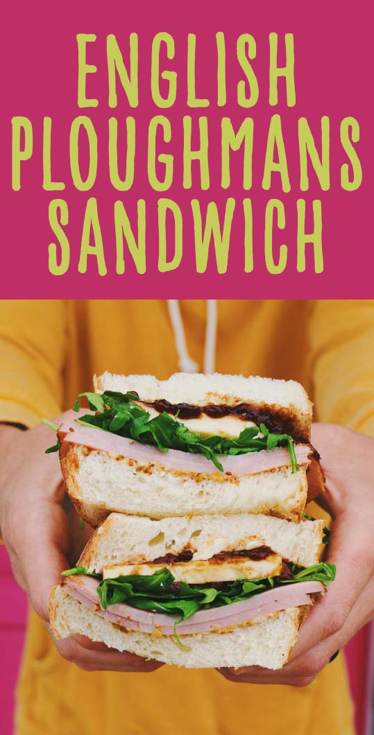 This Ploughmans Sandwich is inspired by the classic British meat and cheese platter. It's loaded with thick cut ham, aged cheddar, branston pickle, salty butter, mustard and arugula between two slices of fluffy white bread. It's a hearty lunch that's packed full of sweet and savory flavors!