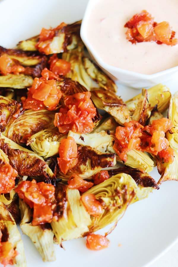 oven fried artichoke hearts on a platter