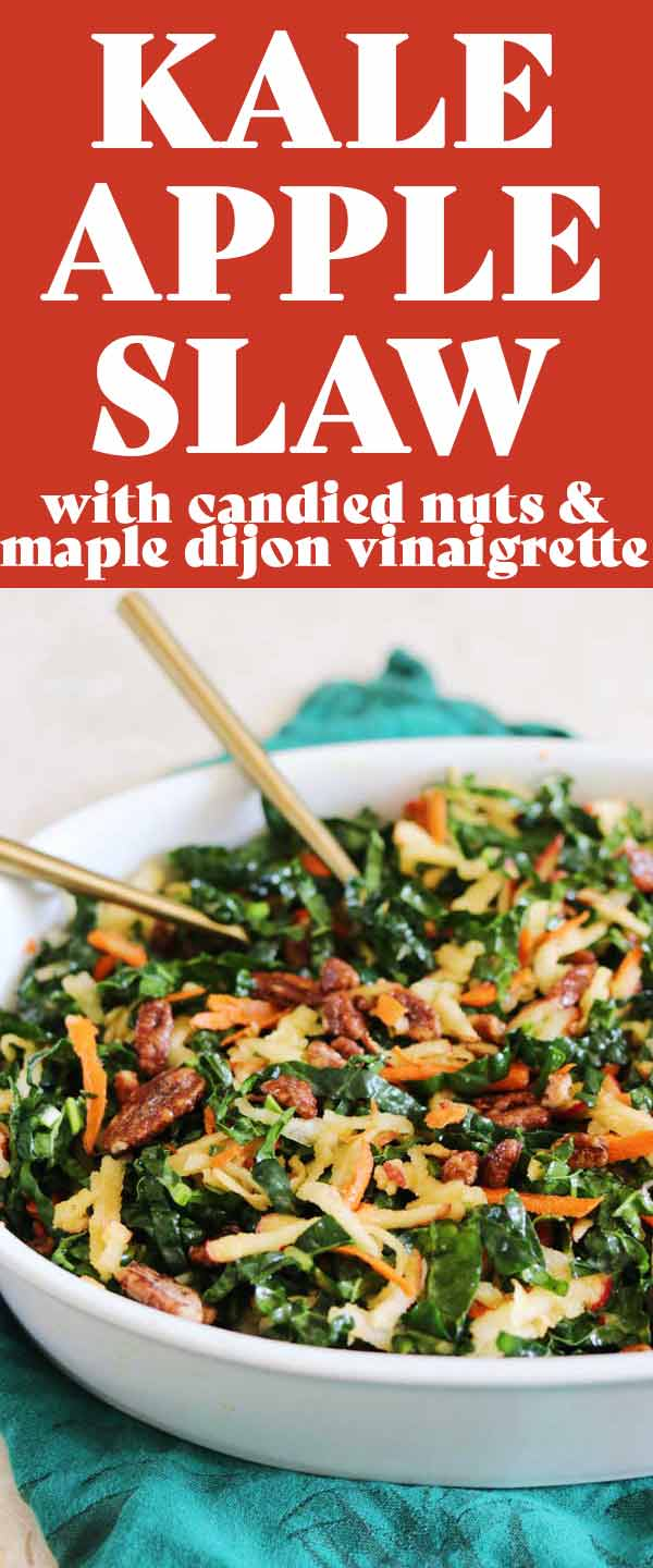 This Kale Apple Slaw is the perfect seasonal hearty green salad. Fresh lemony shredded kale is paired with apples and carrots then tossed in a sweet yet tangy maple dijon vinaigrette. The whole thing is topped which candied nuts for an added textural crunch. #fallfood #fallrecipes #kale #kalesalad #kaleslaw #heartygreens #fall